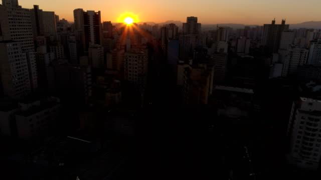 flying trough São Paulo Buildings in sunset