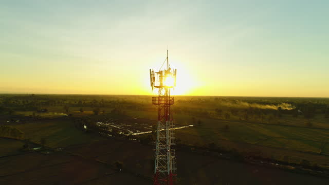 flying up close to telecommunications cellular tower - mast stock videos & royalty-free footage