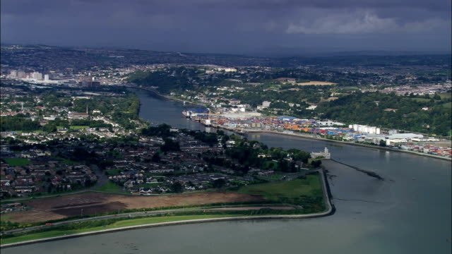 flying up river lee towards cork  - aerial view - munster, cork, ireland - county cork stock videos & royalty-free footage