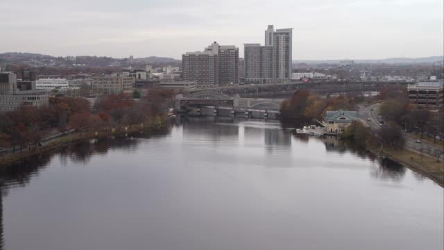 flying up the charles river toward grand junction railroad bridge and boston university bridge. shot in november 2011. - river charles stock videos & royalty-free footage