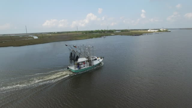 flying up to and orbit around shrimp fishing boat - Drone Aerial View 4K Prawn fishing, shrimp boat, trawler, trawling for ocean fish in the open sea, heavy waves and nets in the water on Louisiana, mississippi coast, gulf coast 4K Transportation