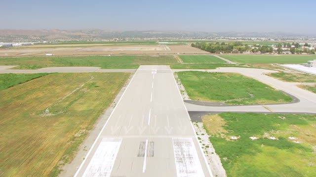 vidéos et rushes de ws aerial pov flying wing taking off at planes of fame museum / chino, california, united states - museum
