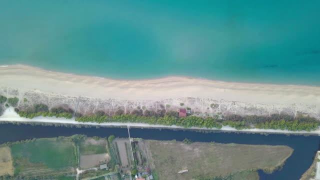 flying with drone above marina of orosei - gulf of orosei -sardinia - pjphoto69 video stock e b–roll