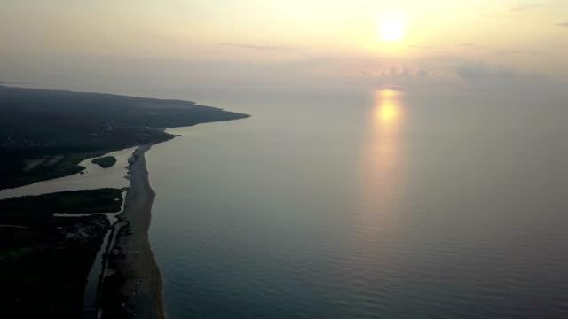 flying with drone at sunrise on gulf od orosei - sardinia - pjphoto69 video stock e b–roll