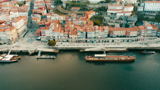 flying with drone in porto above town over the douro river in porto - portugal stock videos & royalty-free footage