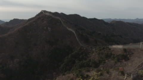 flyover aerial drone shot of the great wall of china and mountains in beijing, china. - aerial or drone pov or scenics or nature or cityscape stock videos & royalty-free footage