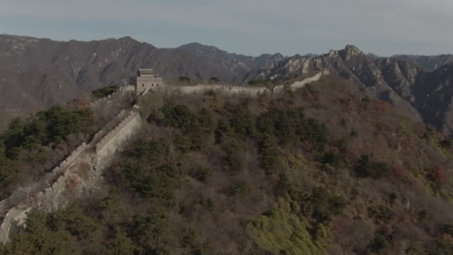 flyover aerial drone shot of the great wall of china and mountains in beijing china - aerial or drone pov or scenics or nature or cityscape stock videos & royalty-free footage