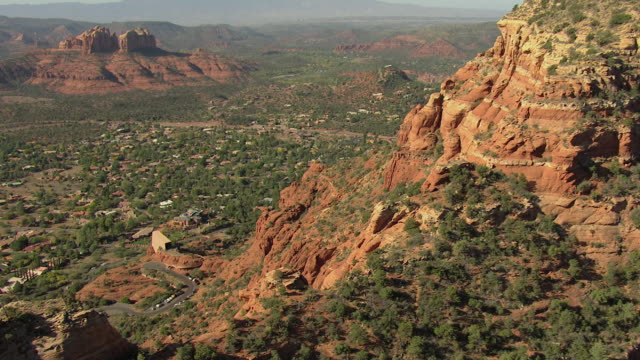ms aerial zi flyover chapel of the holy cross and rock formations / sedona, arizona, united states  - sedona stock videos & royalty-free footage