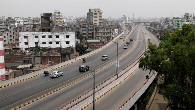 flyover is seen almost empty in the capital city amid spread of the covid-19 coronavirus outbreak in dhaka, bangladesh on march 25, 2020. dhaka, the... - contracting stock videos & royalty-free footage