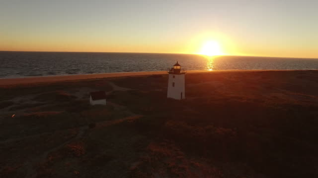 flyover lighthouse at sunset - maine stock videos & royalty-free footage