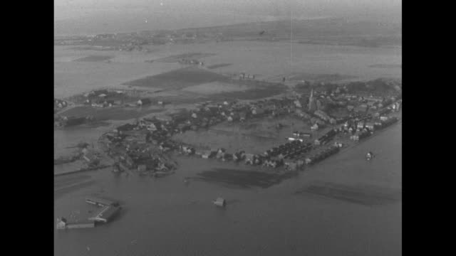 vidéos et rushes de flyover of an isolated town surrounded by water / note: exact day now known - pays bas