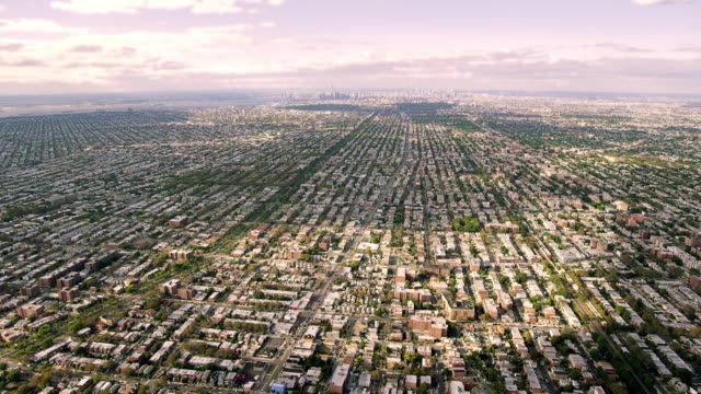 Flyover of city, Manhattan in distance
