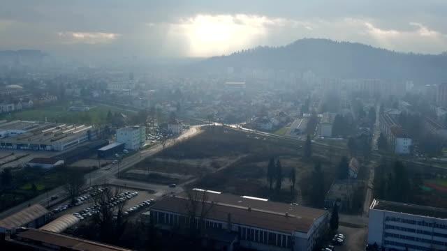 vídeos de stock e filmes b-roll de flyover the industrial area at sunset - eslovénia