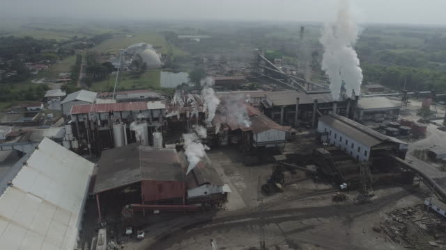 flyovers of sugar processing plant in guatemala - food processing plant stock videos & royalty-free footage