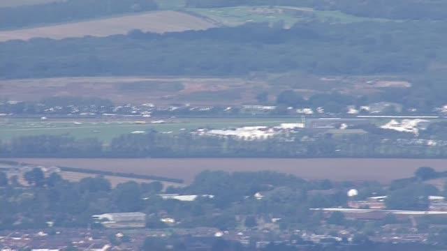 WWII Flypast marks 75th anniversary of Battle of Britain ****BREAK ENGLAND West Sussex EXT AIR VIEWS / AERIALS Area around Goodwood Aerodrome