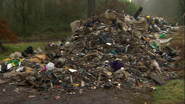 flytipping for large amount of rubbish on housing estate in birmingham by criminal gang - messy stock videos & royalty-free footage