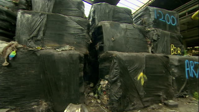 flytipping of tonnes of rubbish in warehouse, dumped by criminal gang - crime stock videos & royalty-free footage