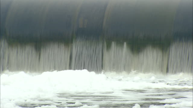 CU Foam piling up at base of spillway in polluted river, Beijing, Beijing, China