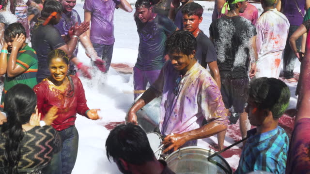 foam pool at holi festival party at india, chennai - powder paint stock videos & royalty-free footage
