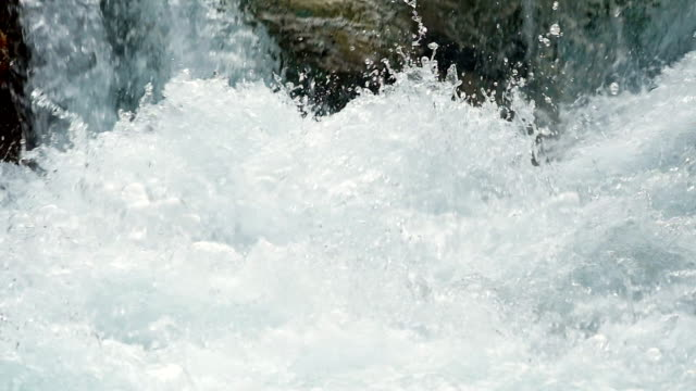 slo mo foaming white water close-up - rapid stock videos & royalty-free footage