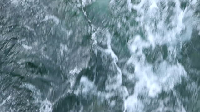 stockvideo's en b-roll-footage met ms foamy greenish water flowing down / lago llanquihue, region de los lagos, chile - stroom stromend water