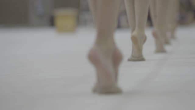 c/u focus change, feet of gymnasts training ballet - ballet shoe stock videos and b-roll footage
