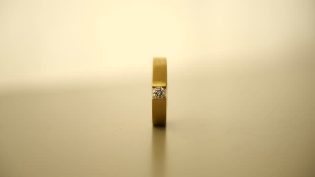 focus on diamond ring, than become invisible in zoom out - sepia stock videos & royalty-free footage