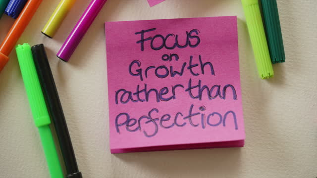 """""""focus on growth rather than perfection"""" affirmation note - sticky stock videos & royalty-free footage"""