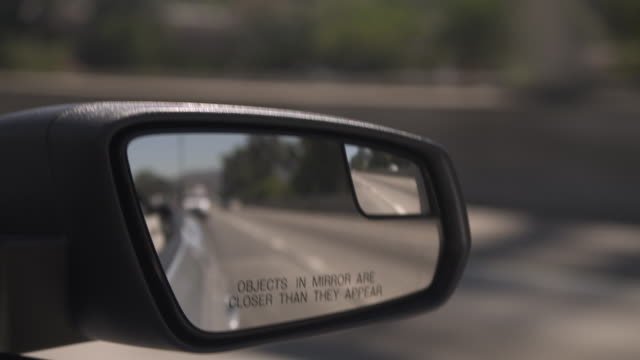 focus on words on a wing mirror reading 'objects in mirror are closer than they appear', california, usa. - wing mirror stock videos & royalty-free footage