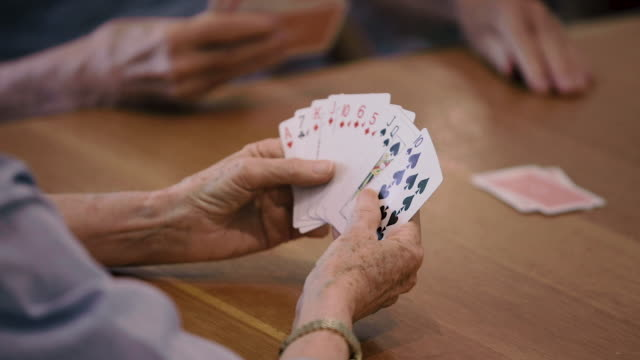 focus pull on a full hand of playing cards - hand of cards stock videos & royalty-free footage