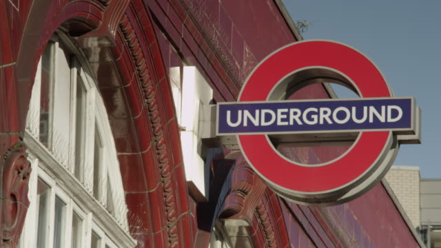 focus pull on london underground sign - entrance sign stock videos & royalty-free footage