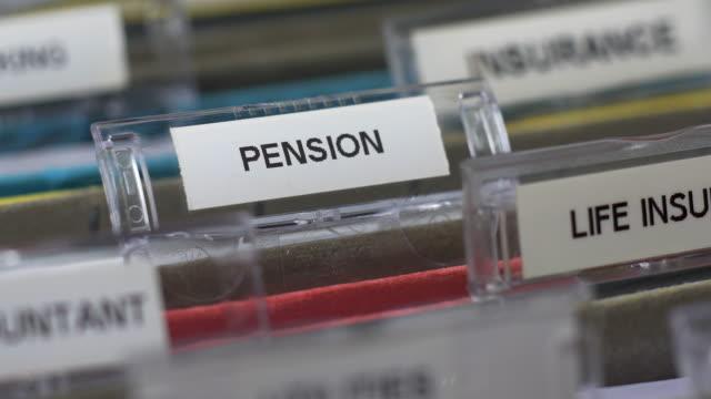 "focus pull to ""pension"" tab on file. - pension stock videos & royalty-free footage"
