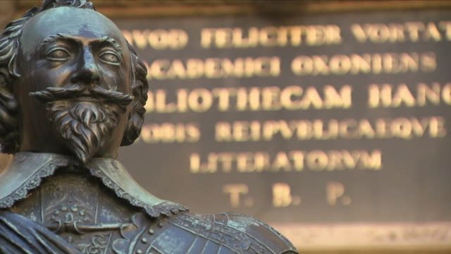 focus shift on statue and latin sign outside bodleian library - bodleian library stock videos and b-roll footage