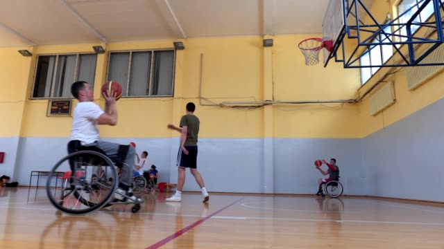 focused and motivated wheelchair athletes training basketball - wheelchair basketball stock videos & royalty-free footage
