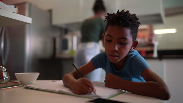 focused boy studying at home - school supplies stock videos & royalty-free footage