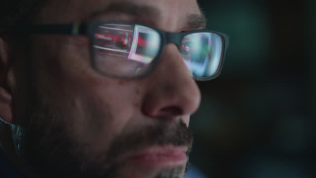 cu focused businessman studying computer screen puts on eyeglasses - computer monitor stock videos & royalty-free footage