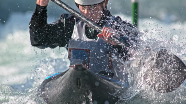 SLO MO Focused face of a male canoeist in canoe slalom competition