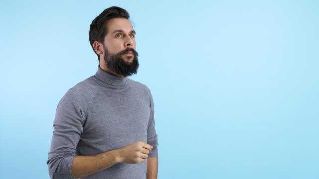 vidéos et rushes de focused man pretending to use an invisible screen/ debica/ poland - invisible