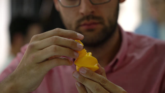 focused man working on a plastic container he just printed on a 3d printer - plastic container stock videos and b-roll footage