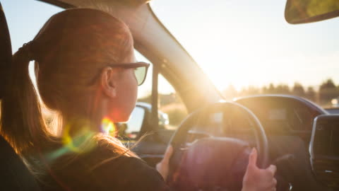 focused woman driver commuting on heavy trafficked road on sunny day - driver stock videos & royalty-free footage