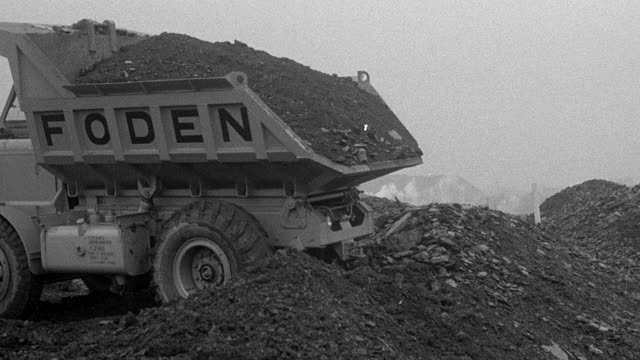 1954 ts foden dump truck backing up and dumping load / arkwright, england, united kingdom - dump truck stock videos and b-roll footage
