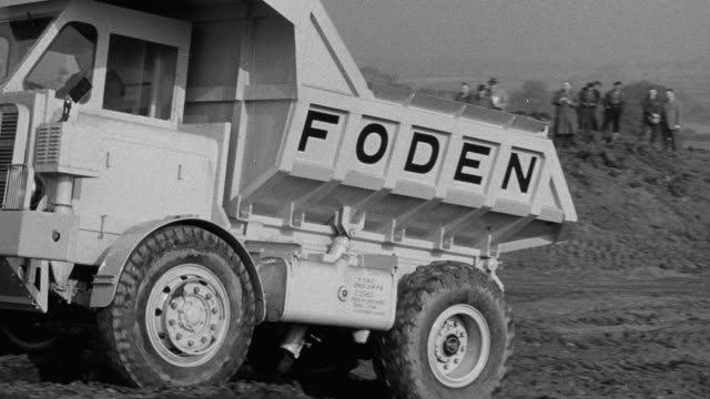 1954 montage foden dump truck climbing soft-surface hill in test run / arkwright, england, united kingdom - 1954 stock videos & royalty-free footage