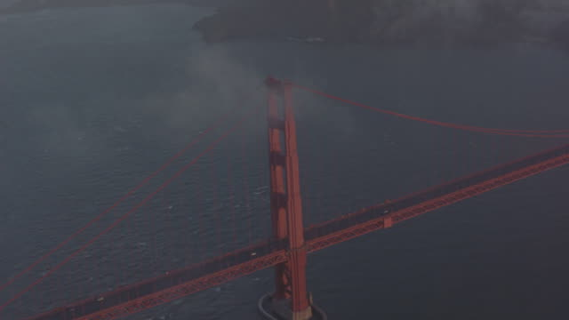 fog above the golden-gate bridge in san francisco. - 50 seconds or greater stock videos & royalty-free footage