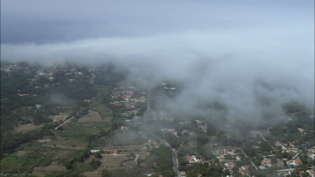 aerial ws fog along coast towards cabo da roca / cascais, lisbon, portugal - cascais stock videos and b-roll footage