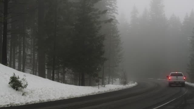 WS Fog and snow on mountain road / Redding, California, USA