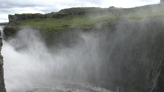Fog and water over the mighty  Dettifoss  waterfall  in Vatnajökull National Park, Iceland  in summertime