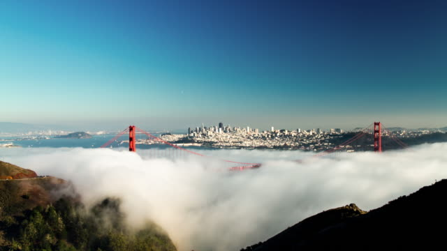 fog at golden gate bridge. 4k. - marin stock videos & royalty-free footage