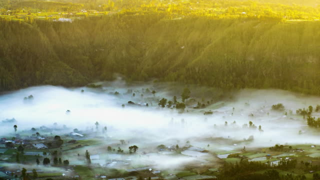fog at sunrise near mount batur, bali, indonesia - 4k time lapse - ubud district stock videos & royalty-free footage