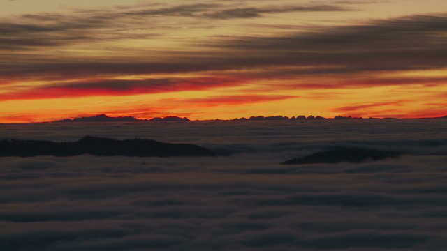 fog before sunrise in front of swiss alps