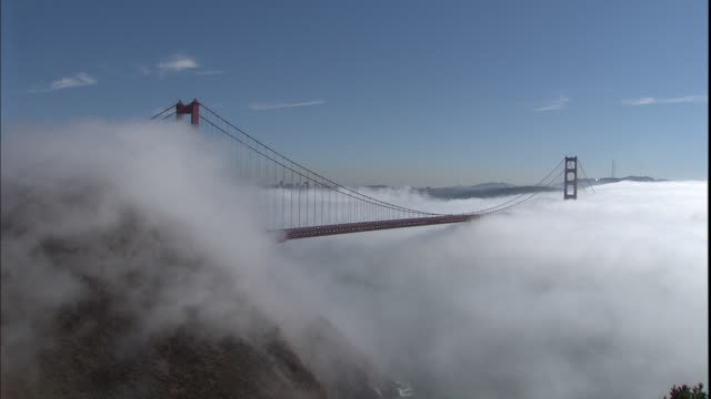 fog blankets the golden gate bridge. - baia di san francisco video stock e b–roll